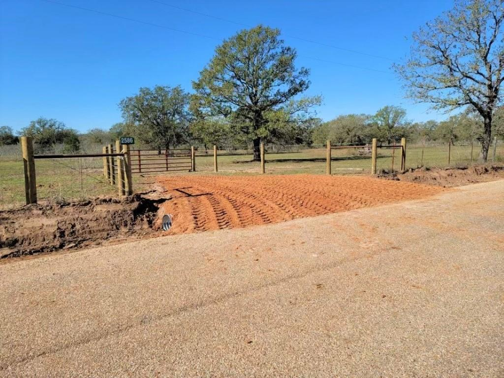 Beautiful 11.8 acre property approximately 20 minutes from Giddings. Partially wooded with oak, cedar, and mesquite trees. Want seclusion? This property offers the opportunity to select and clear the perfect site for a home or weekend cabin. Recently added gate, entrance, and culvert. No restrictions. Minerals negotiable. 3 sides fenced, northern boundary is open to neighboring property for cattle grazing. Ag exempt. Electricity on the property. Lee Co. Water available at county road. Septic and survey needed.