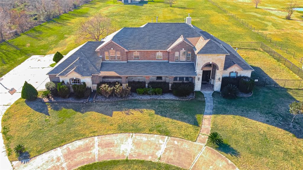 This Custom Estate Family Home on 5.2 acres of unrestricted land will steal your heart. Some special features include a floor to ceiling stone fireplace, second gas fireplace, wet bar, curved staircase, secret room upstairs, separate guest quarters, no carpet, 3 car garage and unfinished Barndominium. Numerous updates have been made including a new roof installed in 2018. Ask your Realtor for the full updates list. A large covered patio and fenced in side yard work great for keeping close watch on young children or small pets. The two-story Barn is fully equipped with electricity and plumbing and it's a blank canvas ready to be transformed into the Man Cave of your dreams! Watching a sunset from the second story balcony is remarkable. Just outside the barn is a fire-pit and outdoor cooking area with a grill and sink. This special property has everything you need for Country living and plenty of space for your dream pool. Easy access to 290. NO FLOODING per seller. Priced to sell!