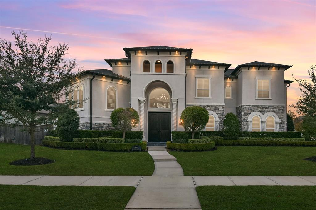 Stunning custom home located in exclusive gated Ironwood Estates of Cinco Ranch. Built by Partners in Building with over 5,500 sq ft of luxury living that includes 5 bedrooms (2 downstairs), 6.5 baths, grand open living spaces, sunken media room & more. Stucco & stone facade with manicured landscaping. Double front doors open to the two story foyer with sweeping staircase. Chef's kitchen boasts double ovens, 6 burner gas cooktop, 2 dishwashers & designer finishes. Soaring ceilings & wall of windows overlooking the backyard in the family room. Luxurious owners suite with walk-through shower, jacuzzi tub & large walk-in closet. Private study features beautiful wood beams. Hidden storage room behind the bookshelf in gameroom. En-suite baths in every room. Plantation shutters throughout. 3 car garage with epoxy-coated floor. Backyard oasis features a gorgeous pool & spa and large covered outdoor living space with outdoor kitchen. Zoned to top Katy ISD schools.