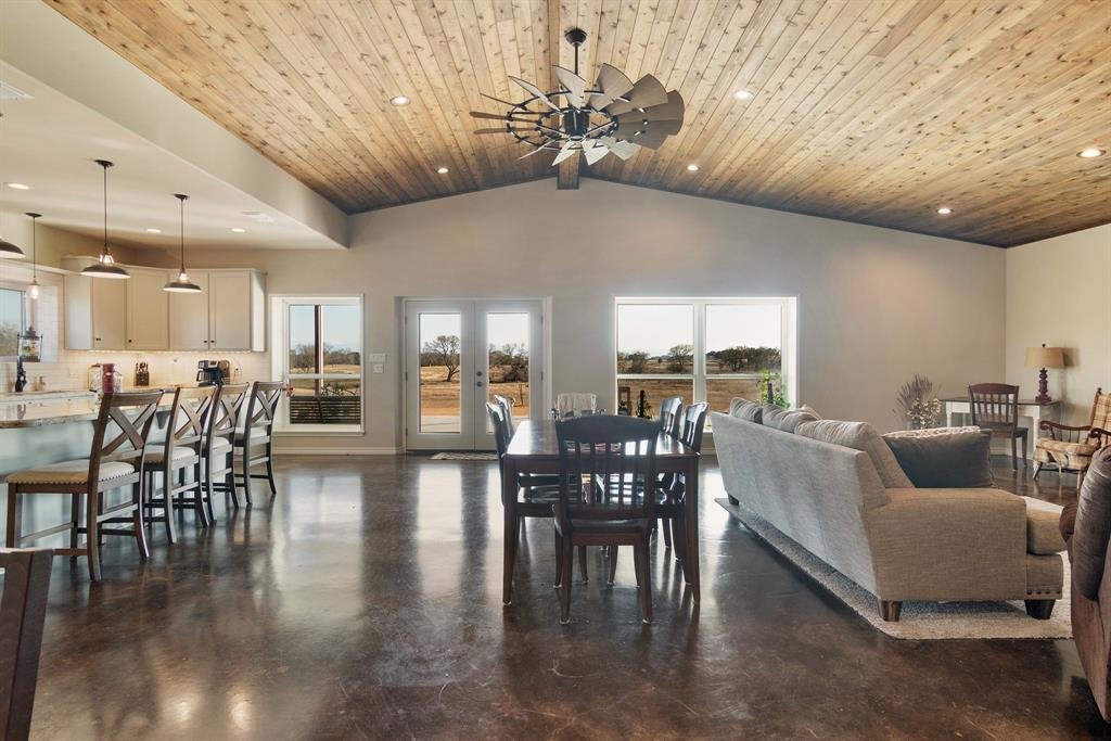 Come enjoy the country life in this 2400 SF home, completed in 2018. Spacious floorplan with kitchen open to expansive dining & living room w/stained concrete floors. Kitchen equipped w/SS appliances, double-oven, propane stove, granite countertops, ample cabinetry, huge island. Large utility room w/sink, fridge, additional storage/desk space. Bedrooms are spacious w/large closets that include built-in dressers. Granite countertops continue throughout the tiled bathrooms. Property also includes: entrance, cattle guard, gate, pond, 3 metal buildings ~ insulated pump house w/tankless water heater, 30x40 insulated metal barn w/full bath, 25 SF lean to, 20x30 detached garage. Impressive view of seasonal creek, rolling countryside, abundant wildlife. Property located on paved farm to market road, conveniently located between Houston, San Antonio, Austin and the gulf coast. It is located in Lavaca County, Weimar ISD, and has a Schulenburg mailing address. Adjoining 18 acres also for sale.