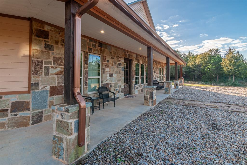 The Rockin M is 36.5 acres located in the much-desired pristine area between New Ulm and Cat Spring directly off the main asphalt road FM 1094. The property is mostly wooded around the perimeter giving you privacy and seclusion where the main house and guest house/party venue is located. This property has a high game fence on two sides and could be used for an event venue, weekend place, hunting property, or a family house out of the big city noise and traffic. It has a total living area of approximately 6,500 sq ft between the main house and guest house/venue, appx 4,050 sq ft of cover porch patio area, 1,600 sq ft of concrete in front of venue, and appx 1,200 sq ft of additional enclosed area that could be used for garage, storage, workout room, etc… Both living areas have an open concept. Primary bedroom has huge, gorgeous shower, closet, bath, and see-through fireplace from bedroom to above the bath. There are too many great features to list. This is truly an outstanding property.