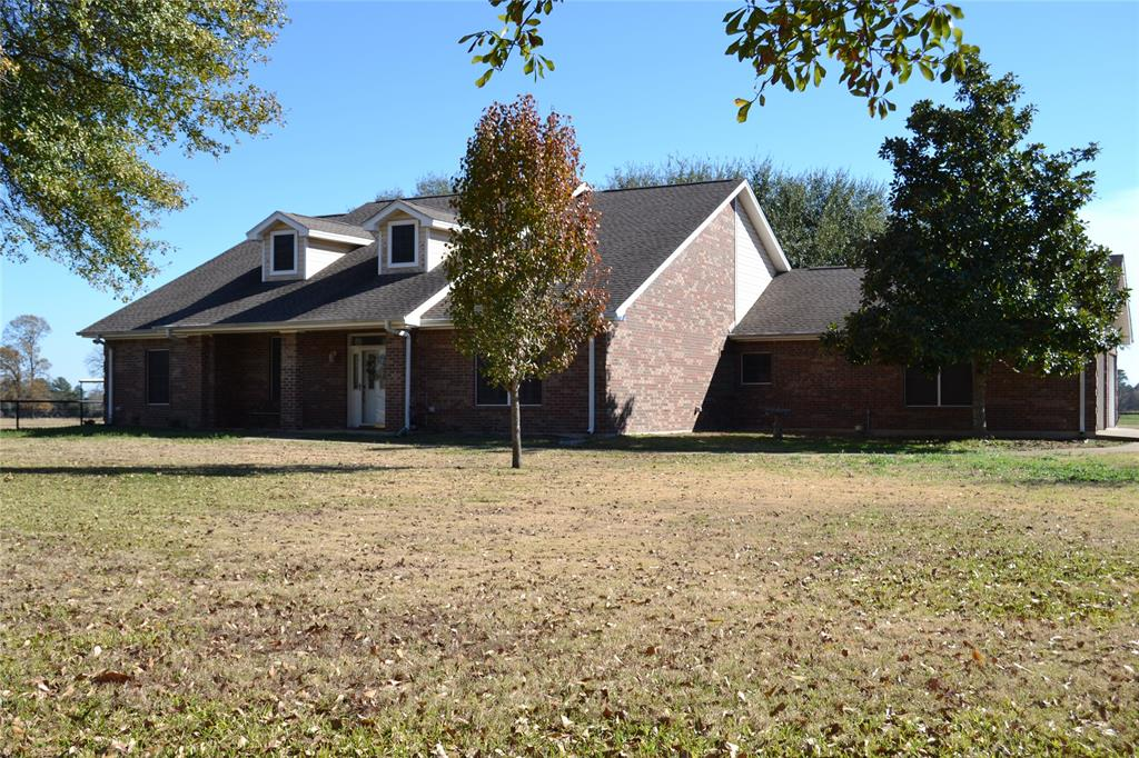 This three bedroom, two and one-half bath home sits on 58.965 manicured acres. The spacious family room has a fireplace to enjoy on cool evenings while relaxing or watching TV. Just off the family room you will find a large open concept kitchen and dining area, as well as a nice size office. Pipe fencing with automatic gate surrounds the home and the perimeter fencing is in excellent shape. The newly established back pasture has been planted with Tifton 9 Bahia and Nelson Rye grass. The front pasture has Pensacola Bahia and Bermuda grass mix. All pastures have been fertilized and limed and there is a nice pond. This property is excellent for hay production and grazing livestock. Located near the home, you will find a fully insulated 30'x30' shop with three overhead doors (one is automatic) In the front pasture, there is a recently constructed 60'x94' all metal pole barn – hay and equipment storage will not be an issue! This property is a must see, call us today!