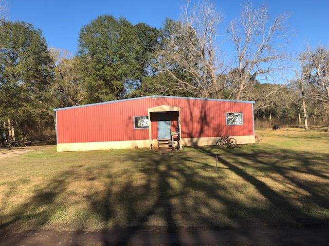 700 square feet metal duplex with 1 bedroom and 1 bath on each side.  This property sit on  7.1 wood acres.  Horses and cattle is welcome.