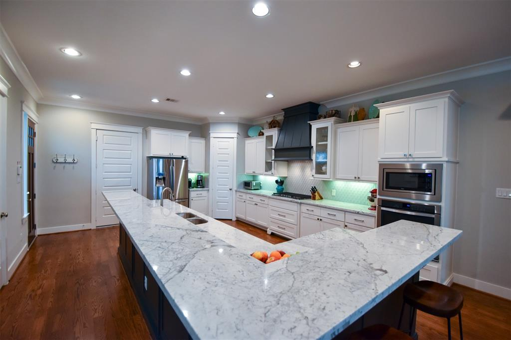 This home is located near Coffee shops, restaurants, breweries, & a hike & bike trail. This luxurious kitchen features a large island and breakfast bar, stainless steel appliances, marble counters, tile back splash, Gas cooking, tons of work space & storage. Hard wood floors and high end touches throughout to include crown molding, recessed lighting and wrought iron stair rails. On the second floor you will find an open gameroom/flex loft area that is currently an office. Generously sized bedrooms & closets. The large primary suite with huge walk in closet is separated from the secondary bedrooms by the loft.  The primary bath features a jetted tub, separate shower & double sinks. Spacious, covered back patio w/optional screens added. Pet friendly artificial turf. 10ft ceilings, spray foam insulation, pex plumbing, radiant barrier & Tankless h20 heater. This home is energy efficient and survived the recent freeze with out any issues.