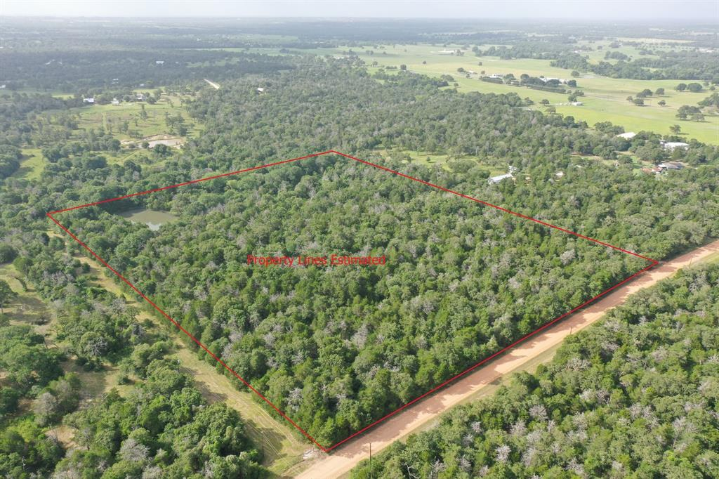 Private, Wooded, Blank Canvas with Stock Pond in Carmine, Texas! Coyote Run Lane is a well-maintained Gravel, Dead-End Road off of the Paved Sandtown Road. Only 7 miles to Burton, 14 miles to Round Top, 19 miles to Brenham, 12 miles to Nails Creek State Park at Lake Somerville, 74 miles to Austin, and 92 miles to Downtown Houston. Land gently slopes from front to back approx. 50-ft in elevation change. Topsoil is Padina loamy fine sand. Property Dimensions are approx. 700 Length x 1,000' Depth. No known restrictions, no known floodplain, no known easements.