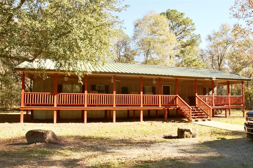 Looking for a turnkey hunting property within an hours drive from Houston? Well then look no further because this property has it all! The owner has taken a once rough patch of woods and spared no expense turning it into a showplace that anyone would be proud to bring guests out to. 99 acres of beautiful hardwoods & Pine contain everything a person could want including all the tools and equipment for anything else they can dream up. This property has an extensive list of items that convey with the the sale including 2 Kawasaki Mules, 2 Kubota Tractors, Case Backhoe, 4 Deer Blinds & Feeders to just name a few.   A 3 bedroom/2 bath camphouse with an amazing 12X60 front porch overlooking the lake is the perfect place to sit and relax while the sounds of nature fill the air. Just off the back of the house is your own personal shooting range to sight in those rifles or just practice with your handguns. Everything a person could want is here and waiting for the next generation to enjoy