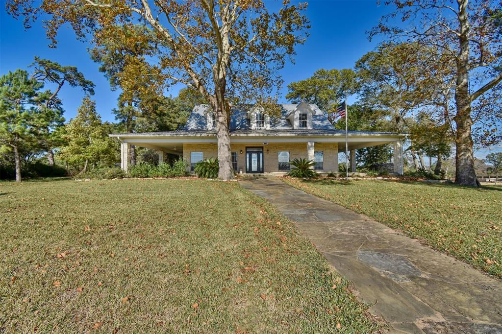 Beautiful rolling acreage located in Austin County. The home is the perfect place to call home or make it your country getaway. From its large kitchen, wood floors, large rooms, and the perfect wrap-around porches give you the ultimate in indoor and outdoor entertaining areas. As you make your way to the back of the property you will find the perfect area for wildlife, beautiful terrain, and a spring-fed creek.  There is also a detached barn for parking and a workshop, a second barn for your equipment storage, and an outbuilding for storage as well.  There is also a charming old farmhouse waiting for you to turn it into the perfect guest house for those large gatherings. It is conveniently located near Bellville, Brenham, and Chappell Hill. With access to both 290 and I-10 for you to commute into Houston. This rare gem is the perfect place for you and your family. Client lost AG evaluation for 2020 but can be reinstated for 2021 per Appraisal  District.