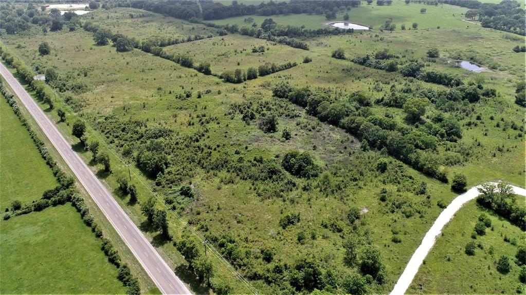 SO MANY POSSIBILITIES!  This 48+/- acre tract is in a great location with frontage on FM 230 and CR 3510. There are many trees on the property along with a nice pond with a deep water well to keep it full. Water and electricity are available making this tract's possibilities endless! Give us a call to schedule a showing today.