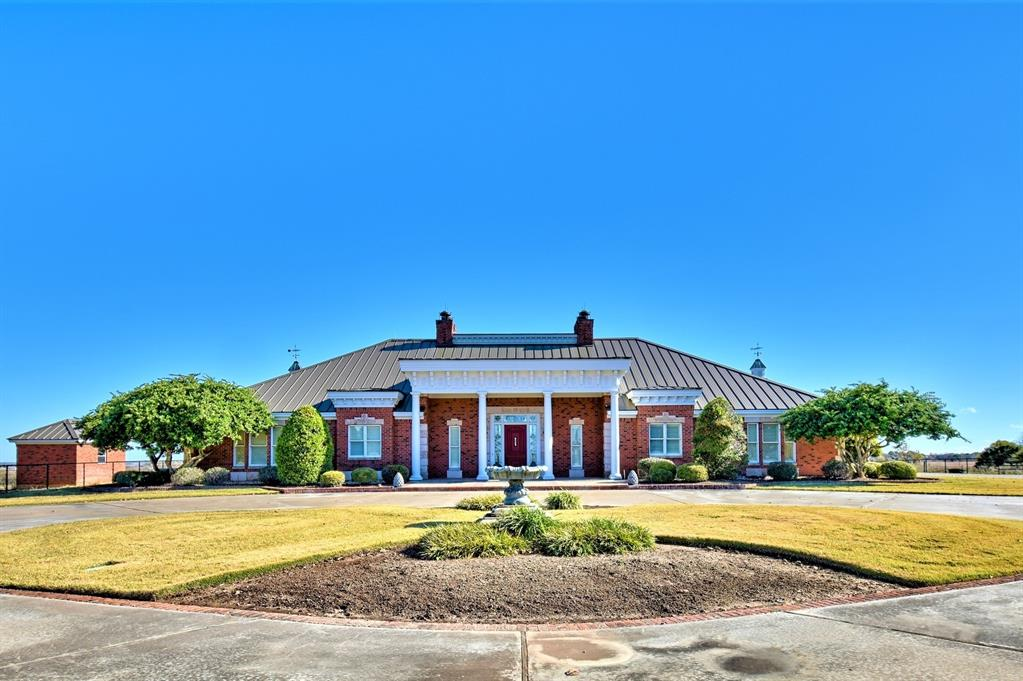 Come experience this classical 1-story, Greek Revival built by Larry Pape, designed by Constantine Barbu on top of a hill with miles of Washington County views on 15+ acres. If your taste leans toward the best of the best, this IS IT!  One owner home and superbly built with no spared expenses in the fine details and designed for entertaining with huge formals, caterer's workroom, chef's kitchen and spacious verandas that link the beautiful interior to the serene, inviting exterior. NOTABLES: Central vacuum system, Ceramic tile throughout house with waterless, stainless epoxy grout, Security System, All bedrooms have separate thermostats (4 zones) and private baths, Custom wood crown moldings with amazing detailed woodwork, Spacious lighted patio with gorgeous Koi pond and fountain, Septic system, Water well and water softener, Well house, Irrigation system in both the back and front yard, cattle guard to pastures, fenced and cross fenced with 4 pastures.
