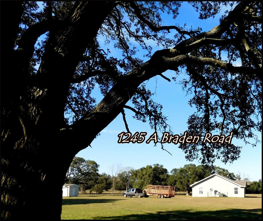 Beautiful land & seclusion awaits you here just off of A Braden Road in the New Ulm/Cat Spring area. This is a highly sought after area &  properties don't seem to come up for sale here very often. Approximately 24.40 fenced acres, a cottage type home built in 2019, Grand Live Oaks, many other mature native trees, & wildlife galore! This 2 bedroom, 2 bath, 2 car garage home is move in ready! The home boasts hardy siding, composition roof, covered front porch, large energy efficient windows, indoor utility, bay window at dining area, pecs piping, concrete/tile/carpeted flooring. The bedrooms are nice size. Enjoy a relaxing jetted tub bath in the master bathroom. The guest bathroom shines with an Onyx Stone walk in shower. This floor plan flows very smoothly. Outdoors enjoy the picnic area tucked away beneath one of the many huge Live Oaks. Hardy storage building/well house is ready for your outdoor items and the double tank septic system are just some of the bonuses.