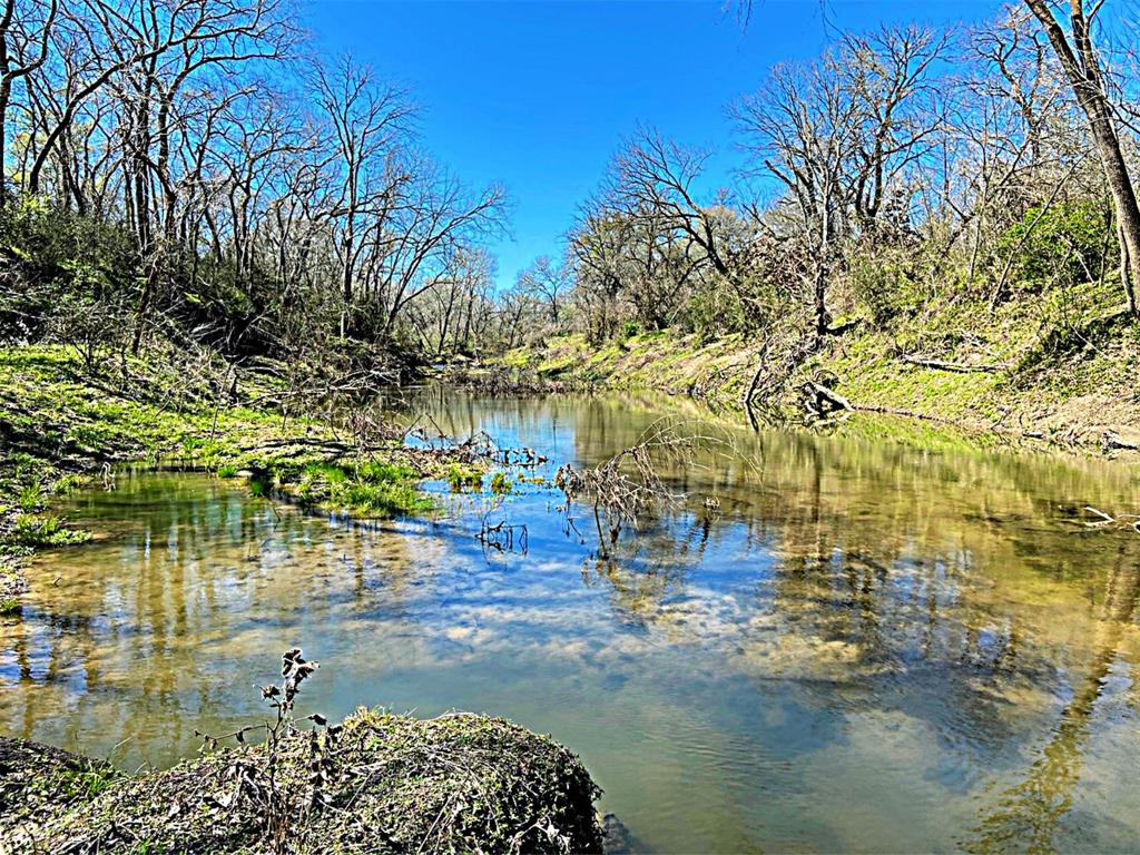 Approx 11 acres on beautiful live water Mill Creek located a short distance from the historic square in Bellville. Easy commute to I-10. Features sandy soil, electric in place, scattered trees and nice wooded habitat for wildlife along the creek, small pond. Ideal spot for homesite. In Bellville ISD. New homes being built in the area, nice neighborhood. Great hard to find medium size tract with convenient location. Enjoy this pretty live water property. List price $16,900 acre. Seller to keep half of owned minerals and waive surface rights. Buyer to verify Ag Exemption for future use.