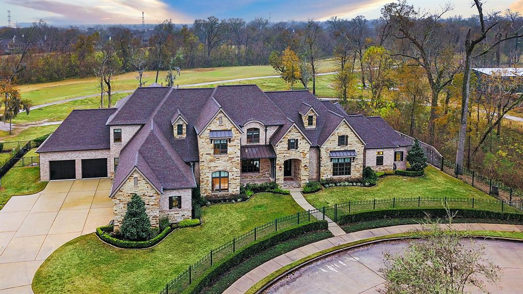 This breathtaking true custom home dazzles with extraordinary living space, premium finishes and an unrivaled location directly on the Sienna Golf Course. Hickory floors, soaring ceilings and handsome millwork throughout. Enjoy lavish entertaining and elegant daily life in the formal dining and sprawling great room. Chef's kitchen includes custom cabinetry, Thermador appliances, plus walk-in and butler's pantries. Main-floor owner's retreat features a spa bath and two WICs — one with a passage to one of two private studies. One guest suite down, plus four well-appointed beds and two baths up. Mudroom, game room, music room, billiards room and outstanding storage. Enjoy seamless indoor-outdoor living with a superb lanai and covered veranda. Located in the coveted Sienna community, surrounded by fantastic amenities including the golf course, swimming pools, water parks, tennis courts and an amphitheater. Enjoy easy access to Sugar Land, Medical Center and Downtown.