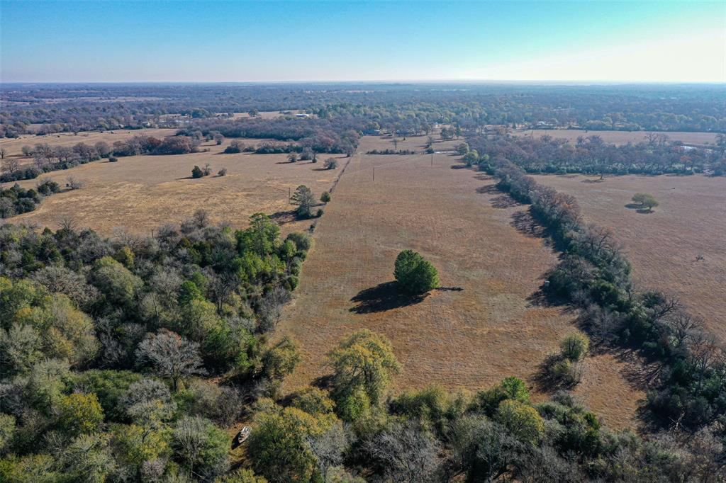 Come to Madison county and see this 24 acre tract, mostly cleared, w/great homesite potential.  The land is quite attractive, with a pretty mixture of trees across the front, a pond just behind them, and then cleared pasture areas toward the back.  Enjoy the peace and quiet, and prepare to relax more, and stress less.  