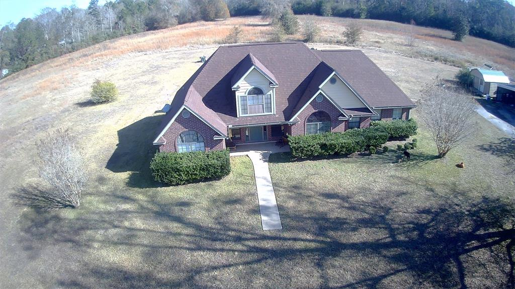 3/2 brick home on 10+ acres.  2 car carport with large workshop.  Large field has been used for baseball practices and has a backstop / bases, etc.  Large corner tract with some trees for privacy.  Home features asphalt driveway, island kitchen, ample storage areas, and vaulted ceilings.  Large patio and deck on rear of home.  Room dimensions are approximate and should be verified by buyers.