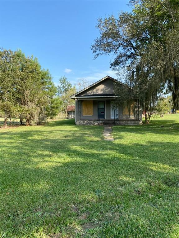 Cute fixer upper home ready for some TLC. Sitting on 14 acres of cleared land. Huge Barn perfect for animal or storage use. Property is completely fenced and conveniently located off of highway 146.