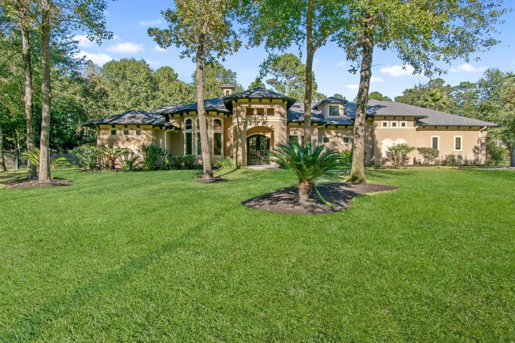 AMAZING PRICE for this award winning CUSTOM home on a ONE ACRE LOT in prestigious Benders Landing! From the moment you walk in you notice high end designer touches, gorgeous travertine & dramatic lighting throughout the home! Living area is a show stopper w floor to ceiling travertine, fireplace & huge bay window overlooking the expansive backyard w pool, outdoor kitchen, & covered patio. Kitchen has custom cabinets, a wall of travertine & a wine chiller built in the oversized island! Spacious primary suite w/ remote fireplace & a door to backyard paradise! Elegant primary bath has an oversized walk in shower, jacuzzi tub surrounded by marble & glass tiled columns & oversized walk in his/hers closets. 3 BDRMS down & a large room upstairs w/ full bath could be the 4th BDRM/gameroom/media! In addition to listed square footage, add in extra 260 sqft flex room detached from home! Think guest/2nd office/workout room! 4 car insulated garage w workshop! Great location, amenities & Conroe ISD!