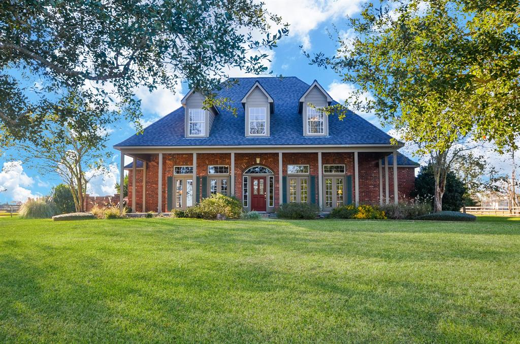 Gorgeous 3358 square foot estate home on 2+ acres plus 650 square foot guest cottage, for a total of 4008 square feet of living area,  located in the highly sought after country neighborhood of Remington Trails in Katy, Texas. Bring your horses and enjoy the pool and water fall, lake view and sunsets on your back porch! This home has it all- granite counter tops, stainless appliances, two primary bedroom walk in closets, tile and wood floors in main house, lovely natural light coming through all the large and numerous windows.  Salt water pool, tankless hot water heaters, recent roof and AC units,  and pavilion that can be used for additional covered parking.  Guest house/pool house has stunning stained and sealed concrete floors, kitchen, bead board ceilings, reclaimed doors and woodworking from Houston, a massive, floored, and air conditioned attic, picture windows looking out to the lake and Geothermal system as well as it's own electric meter.  You don't want to miss this gem!