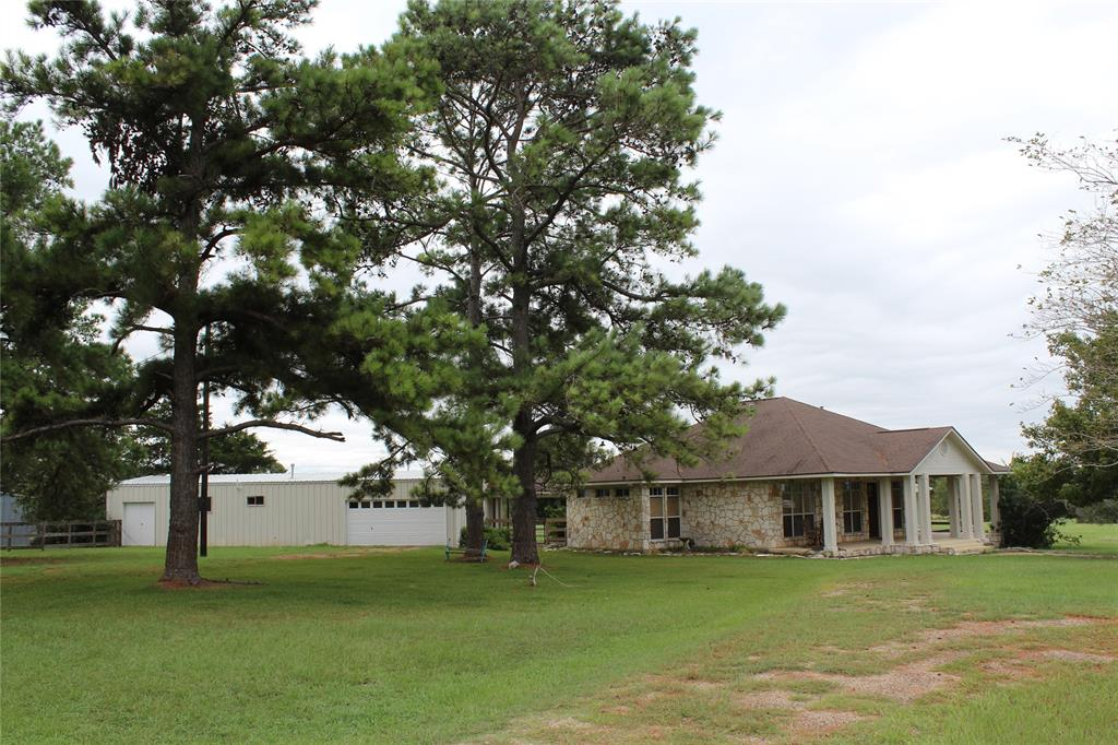 Charming Ranch Home W/Party Barn Located on FM 149 in Anderson, TX 77830. The rolling green pastures feature scattered large trees and great long-distance views. Anderson has a great school district and Grimes county has low taxes. This is a wonderful place to live within commuting distance of College Station, Houston, The Woodlands, etc.  If the property is divided there will be light restrictions. Easy commute to many major cities but still quite country living. Texas High-Speed Rail has a proposed station about five miles from the property. This could make commuting to Houston and Dallas a snap.