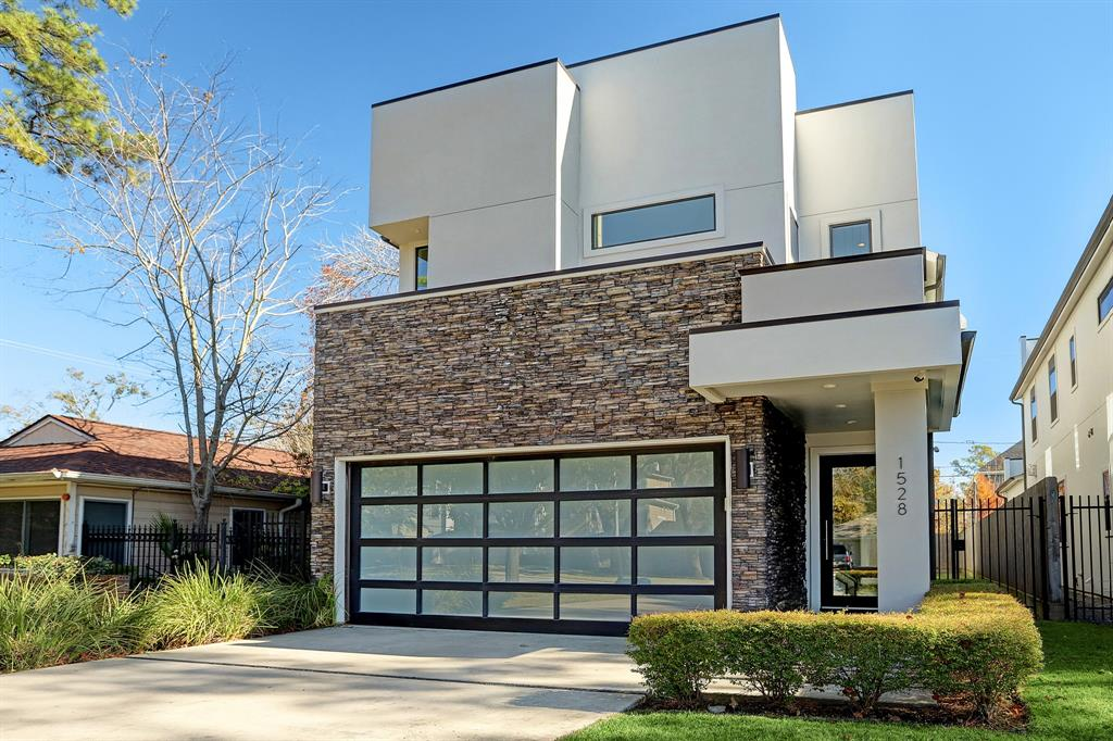 """Builder's own home, tarted out with amazing bells and whistles! Tucked in the heart of Spring Branch, amidst great new and recent construction, this contemporary 4 bedroom home hits all the right notes. From its open floorplan, the stunning open chef's kitchen, the master down with spa-like bath and spacious closet, the """"smart home"""" elements, to the great yard, with room for a pool, this house simply has it all. Beautiful contemporary components include soaring entry, custom glass staircase sides, gas fireplace, fabulous walls spaces for art. The chef's kitchen has a massive quartz island, and open to the living and dining area for wonderful entertaining possibilities. Upstairs, there are 3 secondary bedrooms, a study loft, a generous gameroom with a secondary space, open to an upstairs balcony with a custom glass railing. This is truly a special home to call yours."""