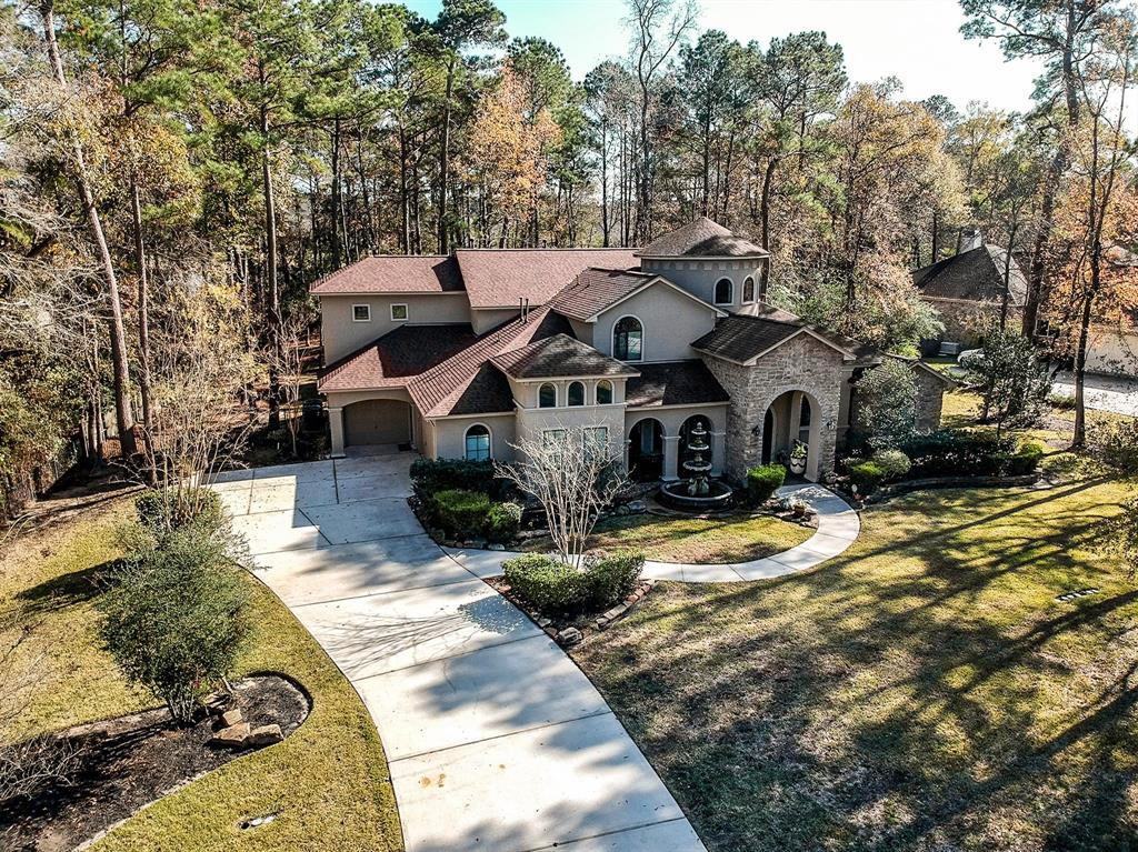 Stunning Custom Home in Lake Windcrest on the golf course with a beautiful waterfront.  Take in the views from the balcony or your patio or take the gorgeous walking trail to your relaxing sitting area by the water. Grand entry into the five bedroom with the primary and second bedroom on the first floor. Along with a study/library elevated by a few steps with double doors. An awesome media room sits off the large game room with balcony. Bar/Butler pantry sits in between the great kitchen and dining room. Great curb appeal with the beautiful fountain, three car garage and a drive way with extra parking. Roof recently replaced with painting and some additional cosmetic items. The primary closet is massive with great closets in all other rooms. This home is a jewell!!! Don't miss out on all it has to offer.  Make your appointment today.