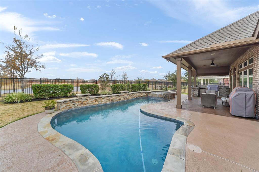 BREATHTAKING PERRY HOME WITH LAKEFRONT VIEW & AN OUTDOOR OASIS WITH A  HEATED POOL & SPA, OUTDOOR FIREPIT, OUTDOOR KITCHEN, & LARGE COVERED PATIO! This home has it all including a private upstairs Game Room, Extra Storage Closet, & half Bath!! Home offers an OPEN CONCEPT with a large gourmet island kitchen with custom cabinets galore & STAINLESS STEEL APPLIANCES! Wood & Tile Flooring through out! Custom Wood Plantation Shutters! This Home is truly  a Vacation Everyday Home! you will be so proud calling this YOUR PARADISE!!