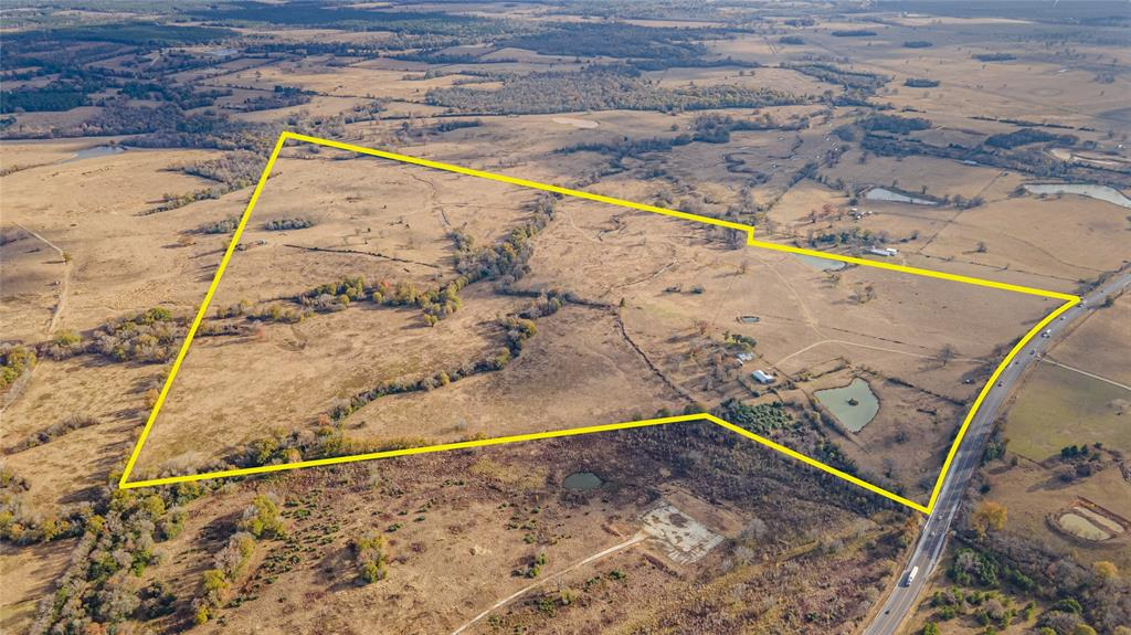 Situated on just over 235 acres in the low-tax area of Houston County, this cattle rancher's paradise boasts large pastures flaunting improvements such as a ranch-style home, fencing/cross-fencing, an oversized barn, a storage building for all of your equipment storage needs, two large ponds, and navigable roads. Looking to build your dream home? Looking for land to develop into a hunting lodge? This property is ready for both! Other property features include access to Lost Creek, which flows through the center of the property and flaunts an abundance of large bass! Located in the center of Dallas and Houston, this 235 acre ranch does not sacrifice ease of access! Property is priced to sell and won't last long. Schedule a showing today!