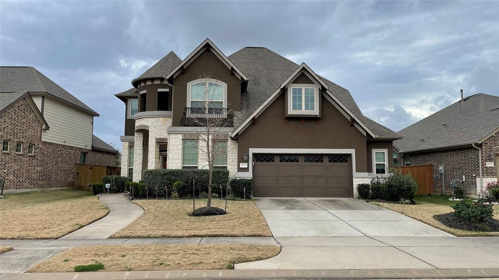 ***MULTIPLE OFFERS RECEIVED. PLEASE SUBMIT HIGHEST AND BEST BY SUNDAY, JANUARY 3RD AT 5PM.*** Beautiful Ashton Woods Bridgeport floorplan with upgraded Stucco Castle Elevation. Front-facing Northeast situated on a large lot with no back neighbors. Backyard is big enough for a pool! This home has 4 beds, 3.5 baths, and 2.5 car garage. Modern kitchen with white cabinets and gray silestone countertops. Soaring 19ft ceilings in the living room with 6 large windows bringing in an abundance of natural light. Upgrades include bay windows in primary, outdoor covered patio with additional slab, vinyl flooring in media, and wood flooring in the study, dining, family, and primary. Move-in ready with blinds, curtains, and sprinklers. Amenities include several playgrounds, lakes with walking trails, and two clubhouses each with a gym, swimming pools, and tennis courts. Conveniently located next to Grand Parkway 99, Highway 90, and Westpark Tollway.