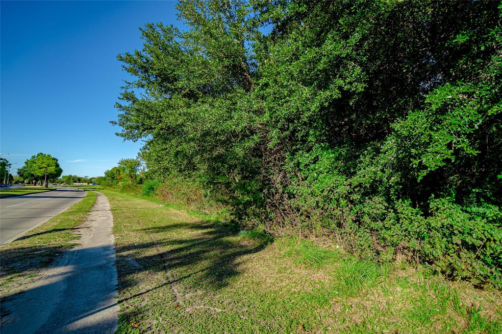 This property is mostly wooded zoned for either residential or commercial use.