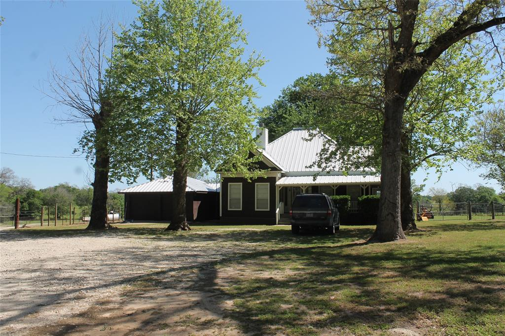 """THIS IS A BEAUTIFUL, APPROX. 206 ACRES. WITH ROLLING HILLS.   COASTAL FIELDS, TRAP FOR HOLDING ROLLS OF HAY. CREEK, ABOUT 7-8  PASTURE(FENCED AND X-FENCED), FENCING OUTSIDE PERMITER GOOD, CROSS- X FENCING GOOD ALSO.  THERE IS GOOD HUNTING , HOG, AND FISHING .    GOOD PIPE WORKING PENS WITH LANE TO RUN THE CATTLE OR ? TO PENS, A CARPORT THAT COULD HOLD SEVERAL TRACTORS AND MISC. THERE IS  A REMODELED 3 BR., 1 BA., WOOD FRAMED HOME ON BLOCKS   IN THE FRONT OF PROPERTY,  HAVING F/P, AND   BEN FRANKLIN F/P IN SUN  ROOM. CEILING FANS THROUGH(LED LIGHTING), 2 WATER WELLS,  AND SEPTIC.  A WRAP AROUND PORCH IS ON TWO SIDES WITH DOOR  GOING INTO SUN ROOM. AND FRONT DOOR.  IT HAS A METAL ROOF.  THERE  IS   TWO CAR ATTACHED GARAGE.    OUTSIDE LIGHT ON LEFT SIDE OF HOME.   THIS IS ONE YOU DON'T WON'T TO MISS. IT IS A """"MUST SEE!!"""