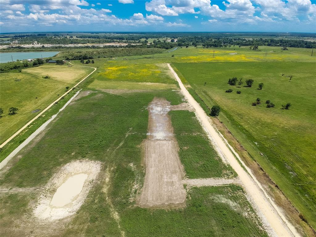 Rectangular tract with elevated road access, pond. Water well installed. Fully fenced with 5 strand barbed wire, wood entrance and metal gate. Land has been under a cattle lease until recently. Access by easement from River Plant Road. Property in AE flood zone. About an hour from Katy.