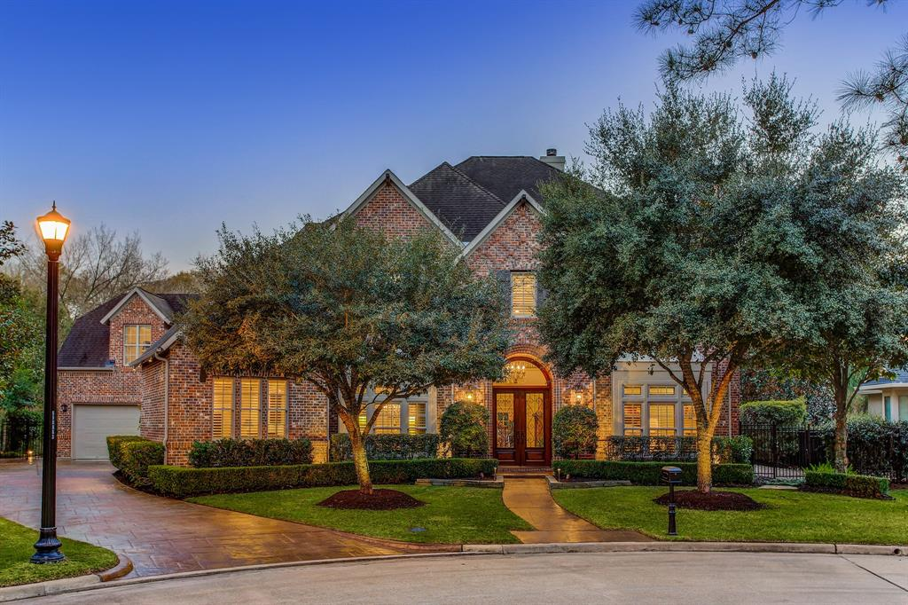 Tucked away in the back of this lovely Cinco Ranch neighborhood, this elegant and stately home sits on just under a half-acre with a fabulous low traffic location near the end of a cul-de-sac. Gated seclusion in coveted Reserve at Bayou Woods and backs to 4+ acre wooded reserve and across the street from an 11+ acre wooded reserve and trails. Car enthusiasts dream – a rare 5 car garage. Over 6,000 square feet, this home boasts exceptional taste, tremendous design with custom features and generous room sizes, great natural light and trending colors. Newly replaced lush carpeting in upstairs bedrooms. Spacious and private first floor master suite views back yard sanctuary with resort sized/style pool with double waterfalls, covered veranda, firepit, outdoor kitchen and pizza oven. Home generator. Exceptional landscaping and stone lined pathways with tremendous attention to detail. Near parks, trails, and all the benefits of Katy life, including top ranked schools. No flooding per seller.