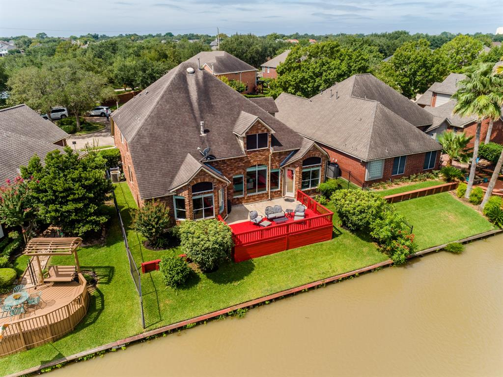 GORGEOUS WATERFRONT HOME IN THE HEART OF SUGAR LAND! LOCATED MINUTES TO EVERYTHING! LOADED W/UPGRADES & UPDATES! SITUATED ON A QUIET CUL-DE-SAC STREET LINED WITH MATURE TREES. BEAUTIFUL FRONT ELEVATION! DRAMATIC ENTRY WITH SOARING CEILINGS & MARBLE FLOORS. TERRIFIC FLOOR PLAN W/BOTH FORMALS, STUDY W/FRENCH DOORS COULD BE CONVERTED TO A SECOND BEDROOM DOWN. LARGE FAMILY ROOM W/2 STORY CEILINGS, BUILT-INS, AND BREATHTAKING WATER VIEWS OPENS UP TO A BEAUTIFULLY UPDATED KITCHEN W/UPGRADED GRANITE COUNTERTOPS, STAINLESS STEEL APPLIANCES AND BUTLERS PANTRY AREA WITH ADDED STORAGE. MASTER SUITE HAS A SITTING AREA OVERLOOKING THE LAKE, MASTER BATH W/SEPERATE SHOWER & TUB PLUS 2 HUGE WALK-IN CLOSETS! UPSTAIRS FEATURES 2 GENEROUS BEDROOMS, GAMING AREA, PLUS A BONUS ROOM THAT FEATURES YOUR OWN PRIVATE SAUNA! LARGE DECK OUTSIDE OVERLOOKING THE WATER IS PERFECT FOR ENTERTAINING! LOCATED MINUTES TO HWYS 59, 99, 90 & 6! LOW 2% TAX RATE! FORT BEND ISD SCHOOLS! READY FOR IMMEDIATE MOVE IN - CALL TODAY!