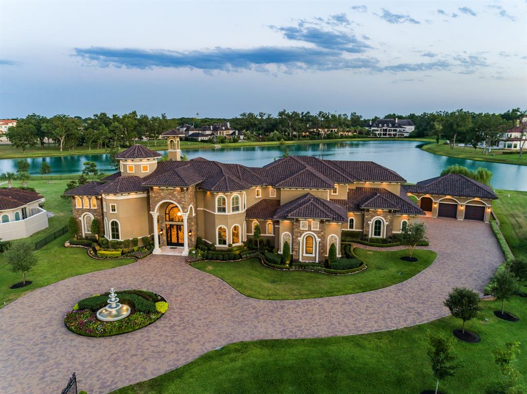 LUXURIOUS, CUSTOM BUILT ESTATE SITUATED ON A 1.5 ACRE WATERFRONT LOT IN THE PRESTIGIOUS GATED COMMUNITY OF SOVEREIGN SHORES ESTATES! BUILT WITH INCREDIBLE QUALITY & ATTENTION TO DETAIL! GORGEOUS STUCCO ELEVATION W/STONE ACCENTS, TILE ROOF, CIRCULAR DRIVEWAY & FOUNTAIN. DOUBLE IRON DOORS LEAD TO A DRAMATIC FOYER W/SOARING CEILINGS, CUSTOM CEILING TREATMENTS, STONE FLOORING & WATER VIEWS. FORMAL DINING ROOM W/SUNKEN WINE ROOM, 2 STORY FORMAL LIVING ROOM VAULTED CEILINGS & STONE FIREPLACE, HANDSOME STUDY W/ GORGEOUS CUSTOM BUILT-INS. LARGE FAMILY ROOM W/BUILT-INS OPENS UP TO A KITCHEN W/DOUBLE ISLANDS, HIGH-END APPLIANCES & CUSTOM CABINETRY. PIANO ROOM W/WARM WOOD PANELING & FIREPLACE.  TERRIFIC FLOOR PLAN W/2 BEDROOMS DOWN! UPSTAIRS FEATURES 3 BEDROOMS, GAMEROOM, GUEST SUITE W/KITCHEN, FLEX ROOM & BALCONY. LARGE COVERED PATIO W/FIREPLACE, OUTDOOR KITCHEN, GROUNDS HAVE LUSH LANDSCAPING! 5 CAR GARAGES! HOME GENERATOR! LOW 1.78% TAX RATE! THIS HOME EPITOMIZES ELEGANCE WHILE EXUDING WARMTH.
