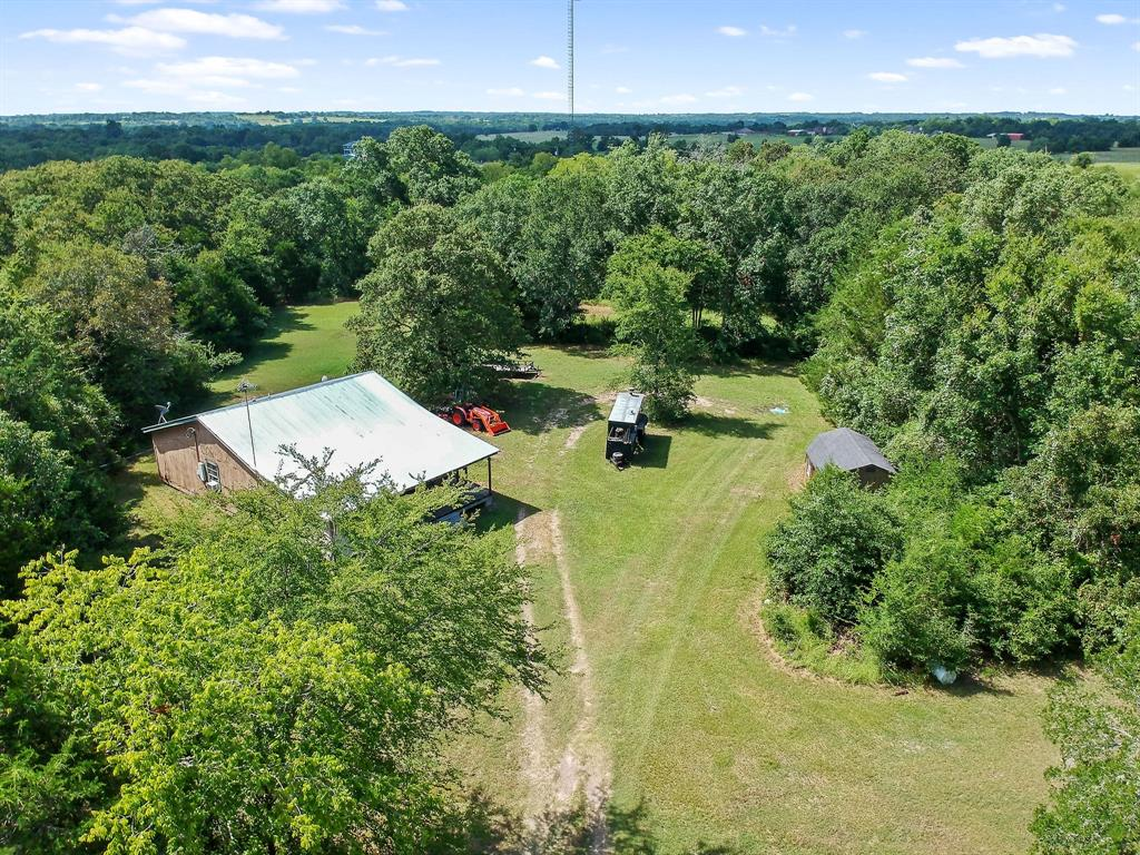 Just a few miles outside of the quaint town of Anderson lies this beautiful 7.975acre track with beautiful lush green trees. The Property has 3 Bedroom, 1 Bath home, Family room, Kitchen with Breakfast area, Laundry room, Master bedroom, Office, Walk-in Closet, and Master Bath. There are some repairs needed - great for small fixer-upper projects! The washer/dryer and The Refrigerator is included.  Covered front porch and 17x14 Storage shed. Low taxes, No HOA fees, no restrictions. Great property for living in Anderson Texas. Anderson is a charming little town that is highly sought after because of its great Anderson and Navasota schools. Located in the rolling hills of Grimes County and in the sought-after Navasota ISD, The property features with gorgeous long distant views of the countryside, paved road frontage, and easy access to both Houston and College Station.