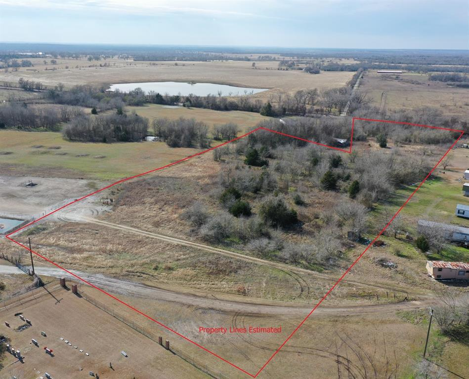 8 acres directly off Farm to Market Road with rolling hills and direct views of Kyle Field Stadium Lights. Build your dream on this blank canvas with access from front of property off farm to market road or from the rear from private road. Minutes from HWY 6, College Station, Historical Anderson and Navasota. Highly sought after Anderson / Shiro schools. Easy commute to Houston with Aggie Expressway or 290. The property has a well. 8 acres to be separated out from existing 10 acres.