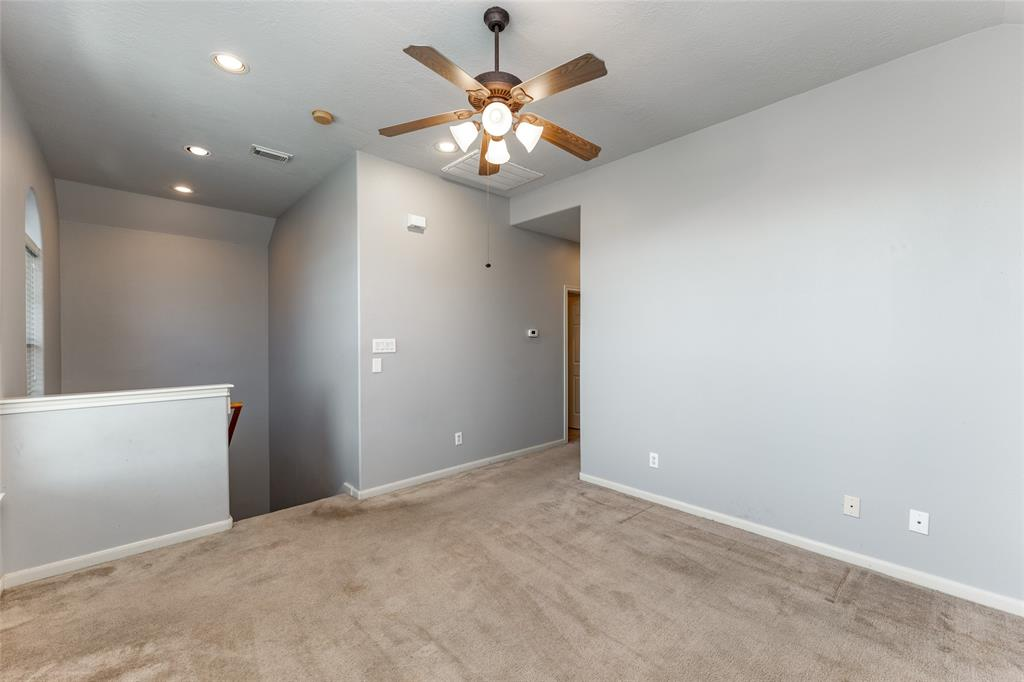 This area would be perfect for an office, game room, or second living room.