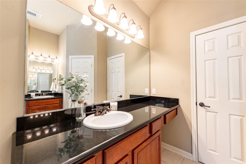 The primary bathroom has double sinks.
