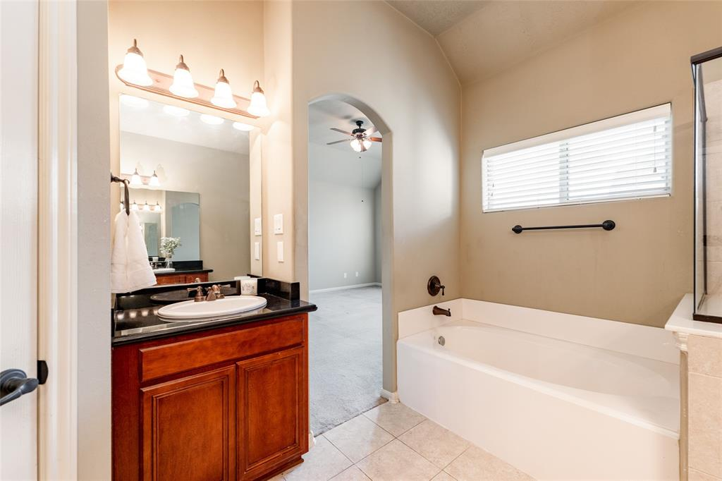 Another view of the primary bathroom with the second sink.