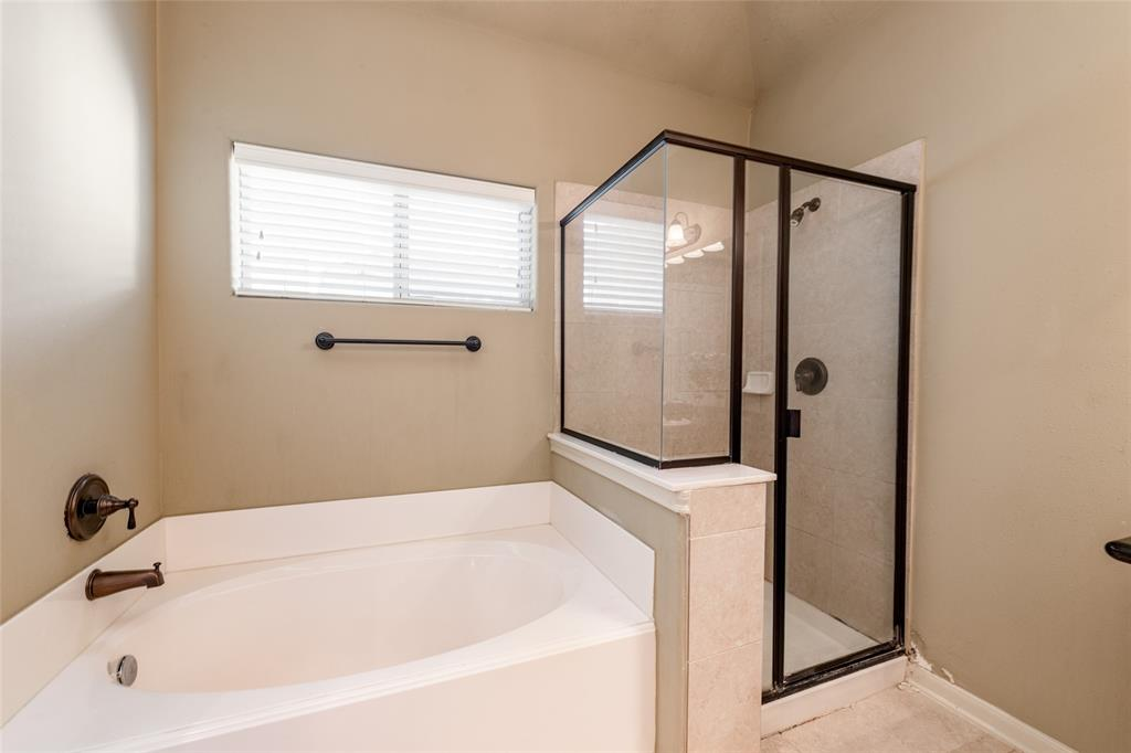 The primary bathroom features a soaker tub and separate shower.