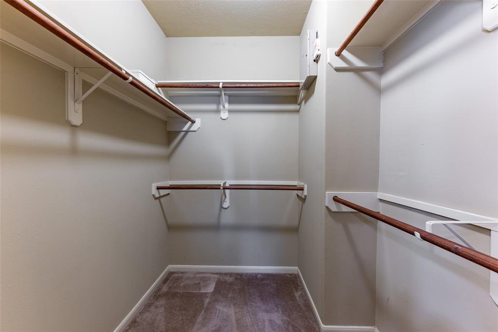 Large walk-in closet located in the primary bathroom.