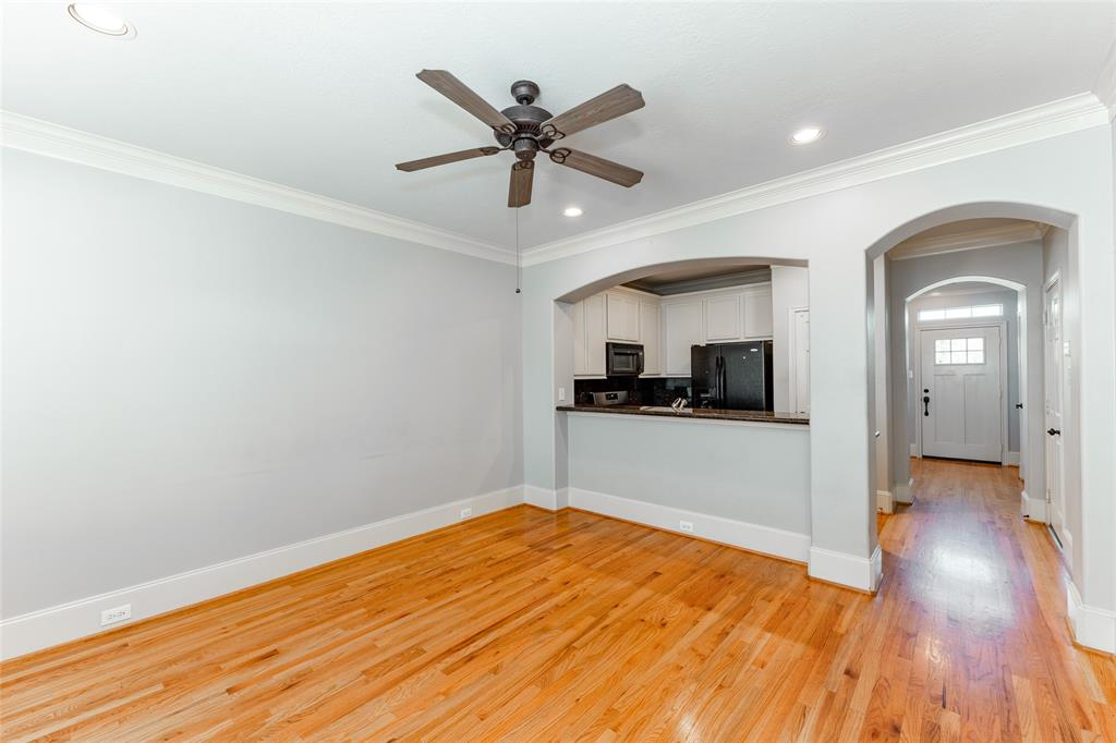 The spacious living room has beautiful hardwood floors.