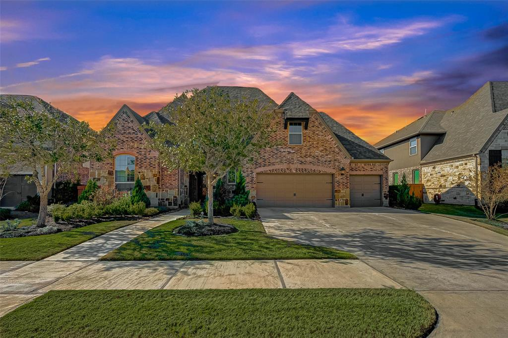 """Come in to this luxurious, immaculate 5 bedroom, 4 full baths and 2 half baths built by Highland Homes that includes the MASTER BEDROOM AND GUEST SUITE ON THE FIRST FLOOR! Dramatic entry leading to a curved staircase across from centrally located study and dining.  Soaring two story ceilings throughout the main areas of the home. The 1st floor features a formal dining room, study, open concept kitchen/living/breakfast area and TWO BEDROOMS W/ 2 1/2 BATHROOMS DOWNSTAIRS. Granite counter-tops, stainless steel appliances, 42"""" cabinetry and a breakfast bar in the kitchen. Private master suite lo overlooking the backyard . The master bathroom showcases his and her sinks, garden bathtub, over sized tile shower and huge closet. The second floor features a game room, media room, three more bedrooms and 3 1/2 bathrooms. 3 CAR GARAGE! Never flooded and not in a flood zone! Aliana master planned community amenities include pools, gym, tennis courts, parks & walking trails."""
