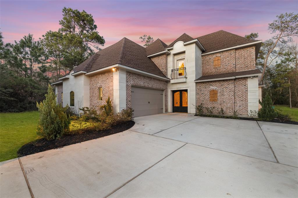 Stunning custom home quietly nestled on over 1 acre lot with great trees in the Estate section of the Benders Landing community. Impressive floor plan includes a quaint casita, first floor study with built ins, large mud room, and upstairs media and game rooms. Classic crown molding, recessed lighting, 14' ceilings, sparkling hardwoods and stained concrete flooring throughout. Spacious living room offers large windows and custom built ins. Gourmet kitchen features a large island with prep sink, top notch granite counter tops, stainless steel appliances and under cabinet lighting. First floor master retreat includes trey ceilings, direct access to the outdoor courtyard, walk in closet, dual vanities, tile shower and garden tub. Expansive back yard provides 3 separate patio areas that are perfect for outdoor entertaining. Residents of this exclusive community enjoy a pool, baseball field, soccer field, basketball court, tennis courts and a large banquet room to host your next big event.