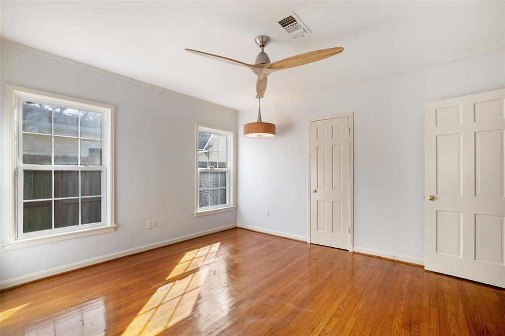 Bedroom # 2 with hardwood floors, fresh paint, and updated ceiling fan.