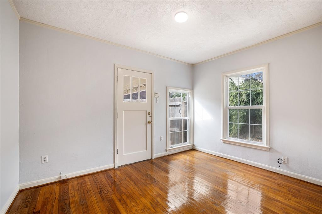 Bedroom # 3 features hardwood floors and fresh paint.