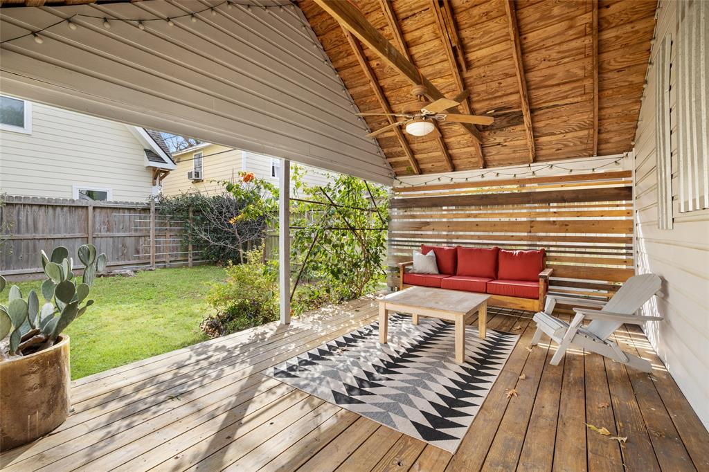 The covered portion of the deck creates an outdoor living space.