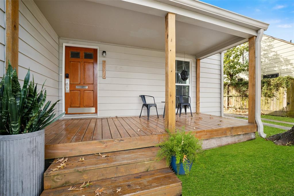 Enjoy your morning coffee on this beautiful covered porch.