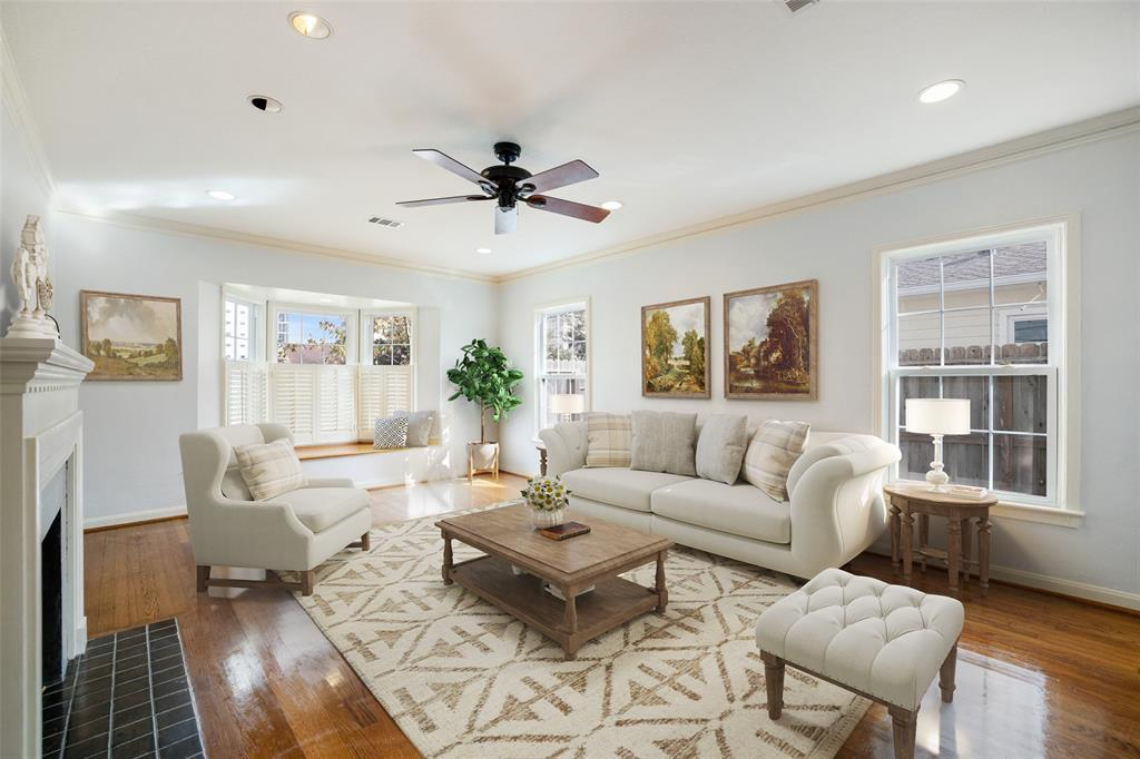The spacious living room features hardwood floors, fresh interior paint and lots of natural light. This photo has been virtually staged.