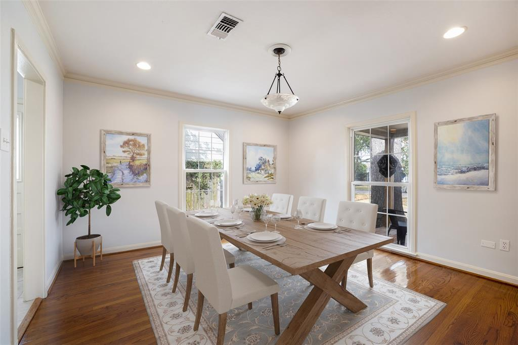 The dining room is adjacent to the kitchen and can easily accommodate a six or eight person table. This photo has been virtually staged.