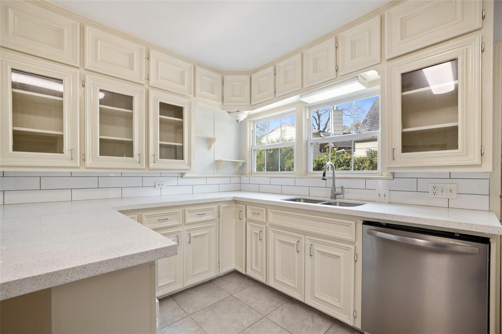 The recently updated kitchen features quartz counter tops, subway tile back splash and stainless steel appliances.